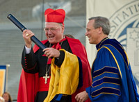 Cardinal Timothy Dolan accepts an honorary degree from Rev
