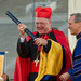 Cardinal Timothy Dolan accepts an honorary degree from Rev. John I. Jenkins during Commencement 2013