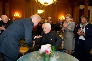 Vice President Joe Biden shakes hands with Father Hesburgh
