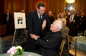 Father Hesburgh blesses Indiana U.S. Sen. Joe Donnelly during the reception