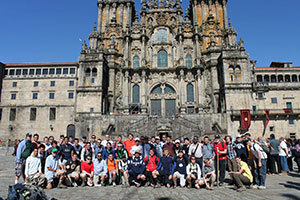 The Glee Club gathers in front of the Cathedral of St. James after finishing the Camino