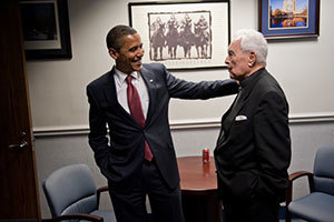 President Barack Obama reacts to Father Hesburgh's friendly advice before the start of Notre Dame's Commencement Ceremonies, May 2009