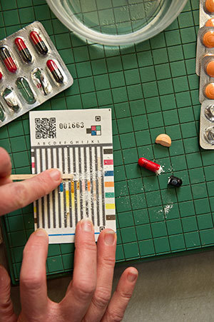 This paper test card is inexpensive way to distinguish substitutes or diluted drugs from real medicines used to treat common bacterial infections and tuberculosis