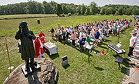 President Rev. John Jenkins, C.S.C., offers mass in honor of the 150th anniversary of the Battle of Gettysburg at the statue of former Notre Dame president Rev. William Corby, C.S.C., in Gettysburg National Military Park