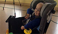 Memorial Hospital patient Austin Rousselow, 2, drives a Little Tikes Hummer car specially outfitted for him by Notre Dame students