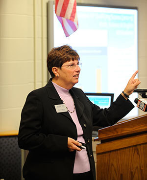 Karen Morris, program director for the AP-TIP IN program in the Institute for Educational Initiatives, presents statistics of the program's first-year success at a news conference at Perry Meridian High School in Indianapolis