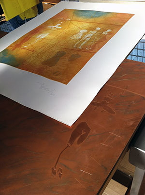 Claudia Bernardi's print, created by the Segura Arts Studio, on top of the copper plates used to make it