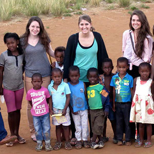 Notre Dame design students Sara Kolettis, Laura Straccia and Maria Massa in South Africa