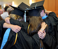 Senior cap and gown hug
