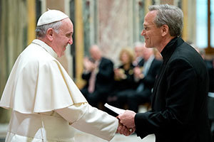 President Rev. John I. Jenkins, C.S.C., shakes hands with Pope Francis. Photo courtesy Vatican Photo Office