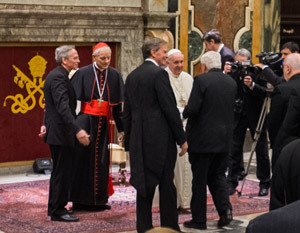 His Holiness Pope Francis shakes hands with members of the Board of Trustees