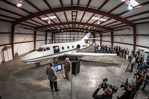 Dr. Eric Jumper, professor of aerospace and mechanical engineering, thanks Matthew McDevitt for the donation of a Falcon 10 during a news event at the South Bend Airport.