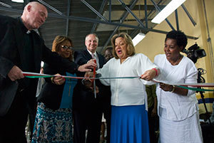 The following dignitaries from Haiti and Notre Dame cut a symbolic ribbon in celebration of the dedication of the new salt factory (L-R): Rev. Thomas Streit, founder and principal investigator of the Notre Dame Haiti Program; Dr. Florence Guillaume, the Haitian Minister for Public Health and Population (MSPP); Earl Carter, managing director of the Notre Dame Haiti Program; Sophia Martelly, the first lady of Haiti; and Joseline Marhone Pierre, director of the Office of Nutrition, MSPP