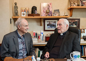 President Emeritus Rev. Theodore M. Hesburgh, C.S.C., meets with former Senator Harris Wofford