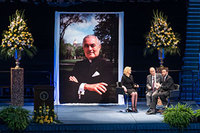 Emcee Anne Thompson chats with former Senator Harris Wofford and Notre Dame Board of Trustees member Martin W. Rodgers during a tribute ceremony in the Purcell Pavilion to honor the life of the late President Emeritus Rev. Theodore M. Hesburgh, C.S.C.