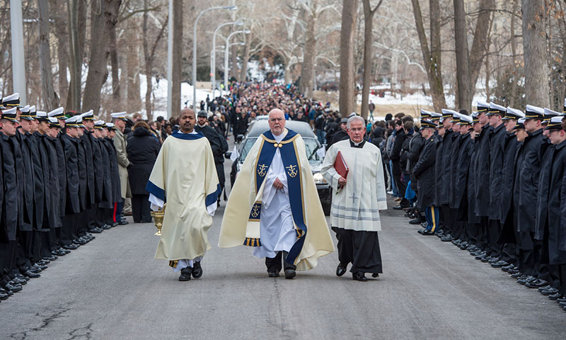 Rev. Thomas O'Hara, C.S.C., Provincial Superior of the Congregation of Holy Cross, leads the procession to the cemetery following the funeral of President Emeritus Rev. Theodore M. Hesburgh, C.S.C.