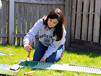 Alisa Finelli, J.D. '15, helps spruce up a South Bend resident's home for Rebuilding Together Volunteer Day
