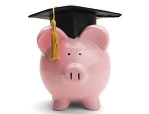 piggy bank wearing a graduation cap