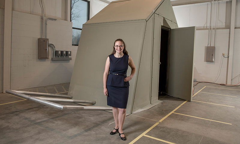 Ashley Thrall with the origami shelter in the Ave Maria Press building