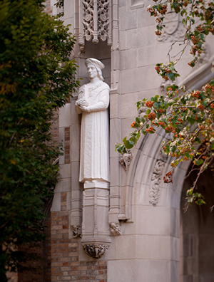 Statue of St. Thomas More on the west entrance to Biolchini Hall