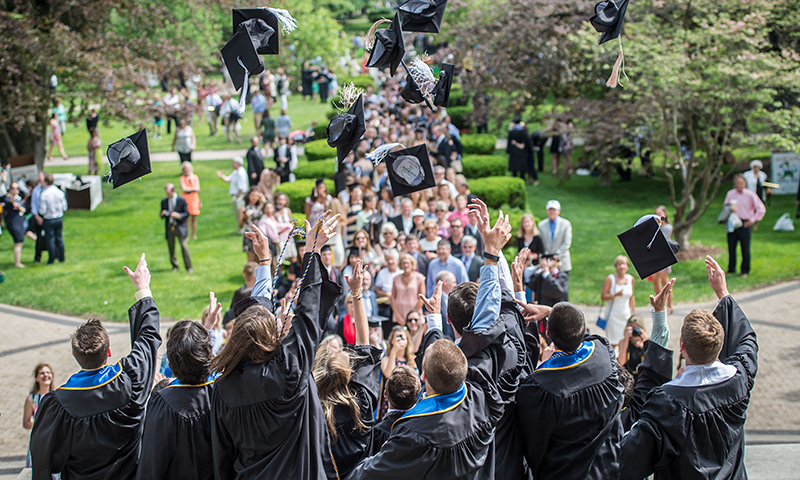 2015 graduates on the steps of the Main Building