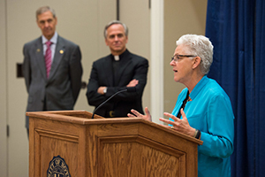 Gina McCarthy, administrator of the U.S. Environmental Protection Agency, speaks at a news conference at the Morris Inn