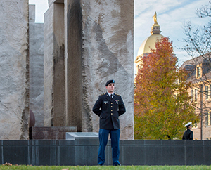 ROTC cadets and midshipmen stand at attention for vigil at the Clarke Memorial Fountain in honor of Veterans Day