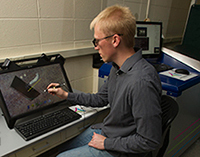 Tyler Curtis, a graduate student, captures images from the spectral CT