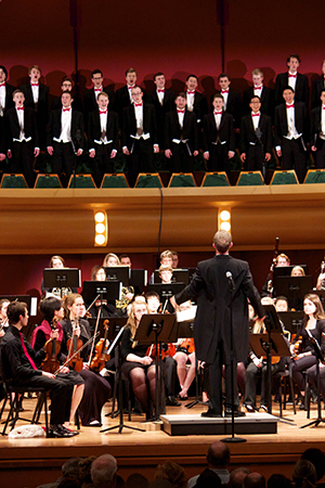 Dan Stowe conducts the NDSO during the combined NDSO/Glee Club Christmas concert in 2015