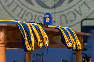 Hoods for honorary degree recipients sit on a table with the Laetare Medal before the 2015 Commencement ceremony