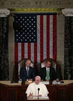 Pope Francis addresses a joint meeting of the U.S. Congress while Vice President Joseph Biden and House Speaker John Boehner (R-OH) listen, at the U.S. Capitol on September 24, 2015 in Washington, D.C. (Photo by Mark Wilson/Getty Images)