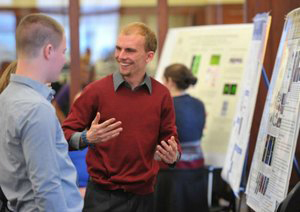 Student researcher Kyle Cowdrick presents at the 2014 Harper Cancer Research Day