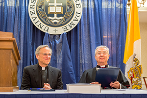 Rev. John I. Jenkins, C.S.C., and Archbishop Jean-Louis Brugues, archivist and librarian of the Holy Roman Church, sign a memorandum of understanding for collaboration and exchanges between the Vatican Library and Notre Dame