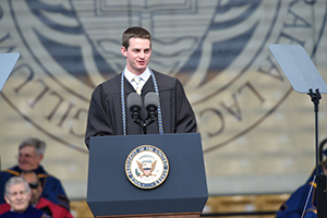 Salutatorian Stephen Schafer delivers the invocation at the 2016 University Commencement Ceremony