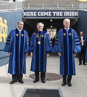 President Rev. John Jenkins, C.S.C., is flanked by Laetare Medal recipients John Boehner, former Speaker of the House (left), and Vice President Joe Biden before walking onto the stage for the 2016 Commencement Ceremony