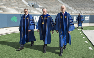 President Rev. John Jenkins, C.S.C., is flanked by Laetare Medal recipients John Boehner, former Speaker of the House, and Vice President Joe Biden before walking onto the stage for the 2016 Commencement Ceremony