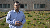 Postdoctoral researcher Ashish Sharma stands on a green roof
