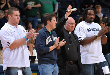Rev. Thomas Streit, C.S.C., and Notre Dame student-athletes