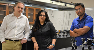 Boldizsár Jankó, left, Rusha Chatterjee and Masaru Kuno stand in the Kuno lab at Notre Dame