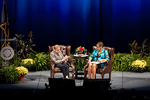 United States Supreme Court Justice Ruth Bader Ginsburg reads from a pocket copy of the United States Constitution during a conversation with U.S. Court of Appeals Judge Ann Claire Williams