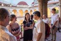 "Peter Casarella, director of Latin American/North American Church Concerns, speaks with undergraduate students after the opening session of a colloquium in Cuba which initiated a three-year study, led by Casarella, of Pope Francis' ""Teologia del Pueblo"" (Theology of the People)."