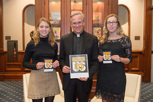 "Father Jenkins signed the ""It's On Us"" pledge Oct. 27 in a ceremony in his office with Becca Blais and Grace Watkins"
