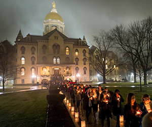 Participants form a candlelight procession following a prayer service in the Main Building in observation of Martin Luther King Jr. Day.