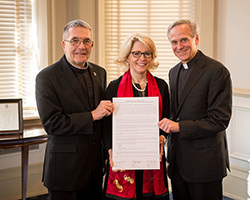 Brother John Paige, C.S.C., president of Holy Cross College, Jan Cervelli, president of Saint Mary's College and Rev. John I. Jenkins, C.S.C., president of The University of Notre Dame