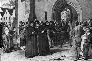 Martin Luther Hammers the 95 Theses to the Church Door of Wittenberg