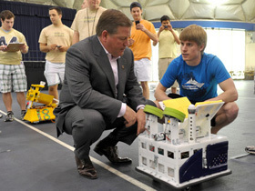 Coach Kelly with robot football