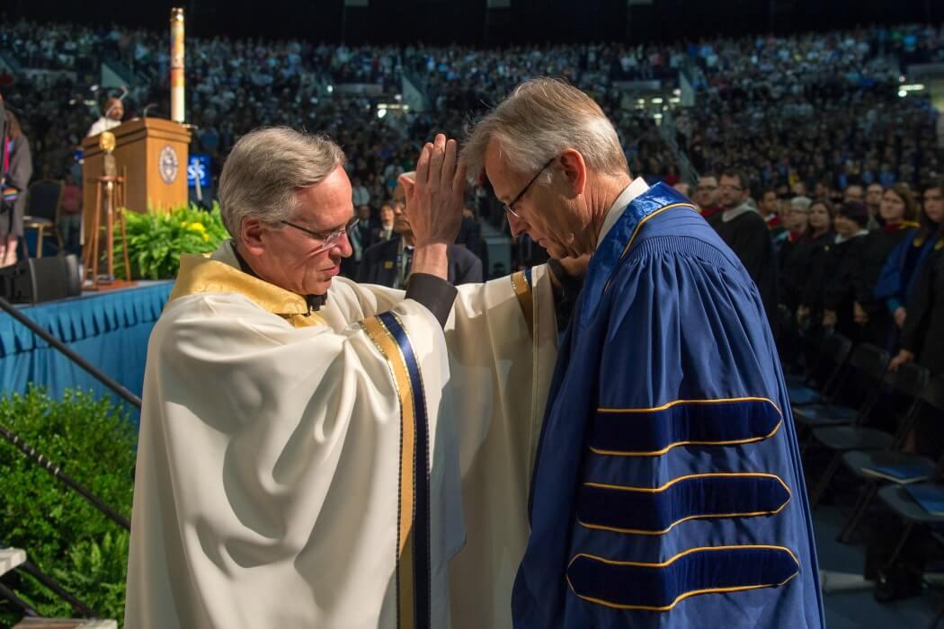 Fr. Jenkins blesses Rev. Junge.