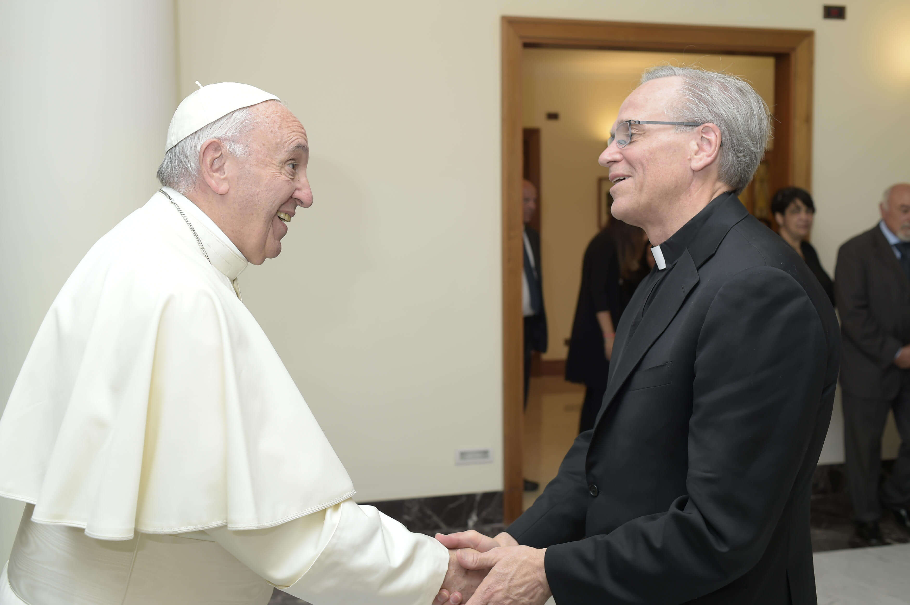 Rev. John I. Jenkins, C.S.C., shakes hands with His Holiness Pope Francis