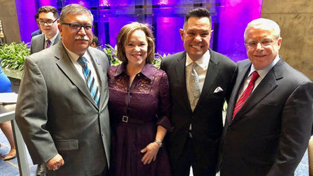 Luis Fraga (second from right), with (from left) ILS Advisory Council member Phil Fuentes; Fraga's wife, Charlene Aguilar; and ILS Advisory Council member Joe Power.