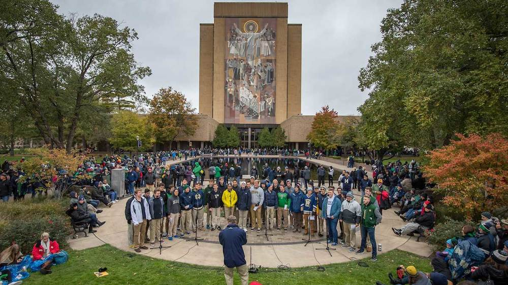 The Notre Dame Glee Club performs on the Library Quad before a football game